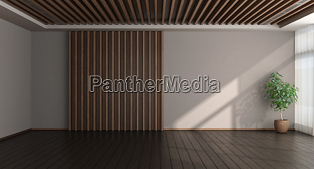 empty room with wooden paneling on