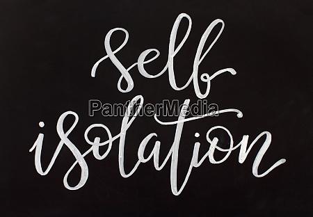 chalk inscription self isolation on a