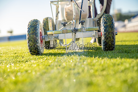 lining a football pitch using white