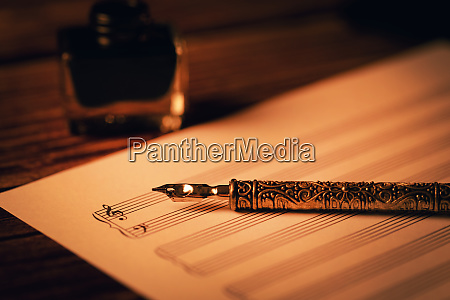 vintage quill pen on blank music