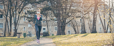 woman jogging down a path boosting