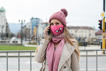 woman with fashion mask using her