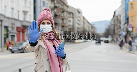 woman in empty lockdown city giving