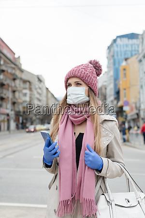 woman in empty city in lockdown