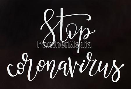 chalk inscription stop coronavirus on a