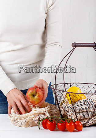 woman put fresh fruits in a