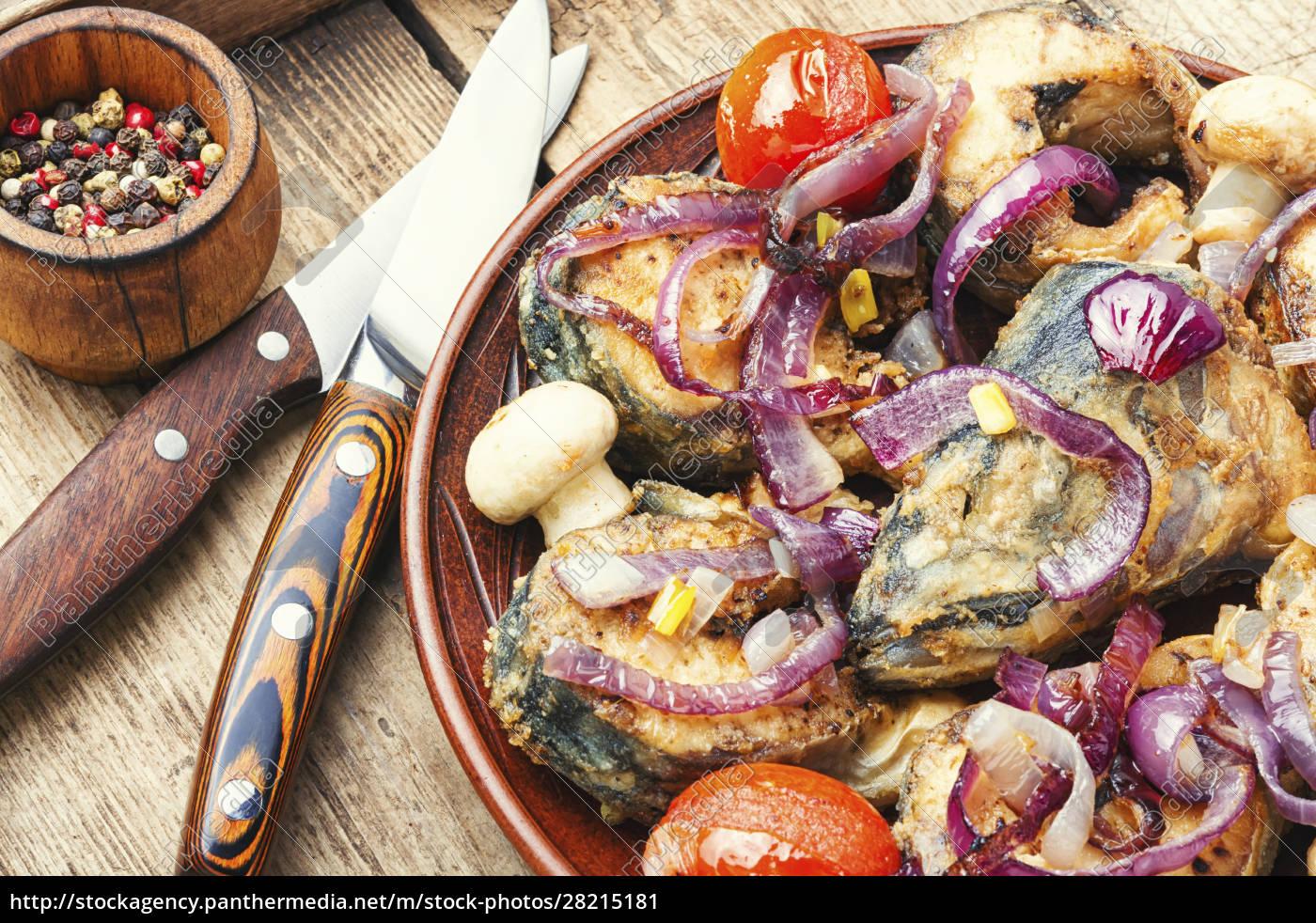 mackerel, fried, in, tomatoes - 28215181
