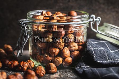 peeled, hazelnuts, on, old, kitchen, table. - 28215592