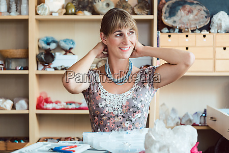 woman, trying, a, necklace, hand, made - 28215172