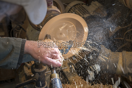 making, a, wooden, bowl, on, a - 28217614