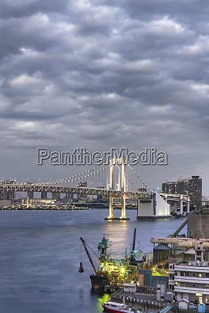 rainbow bridge with cargo and cruise