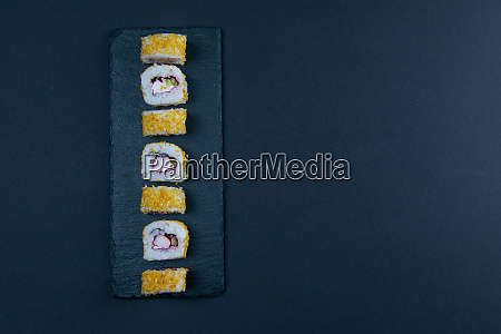 granit board with sushi filled with