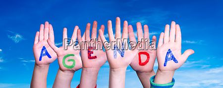 children hands building word agenda blue