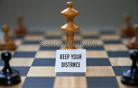 concept chess pieces expressing social distancing