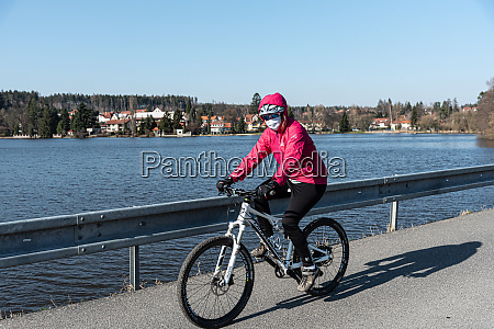 female biker with face masks on
