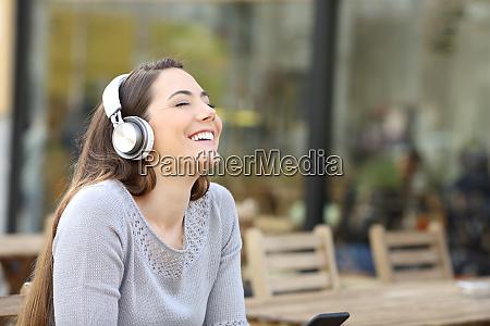 happy woman breathing fresh air listening