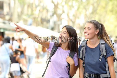 backpackers sightseeing in the street finding