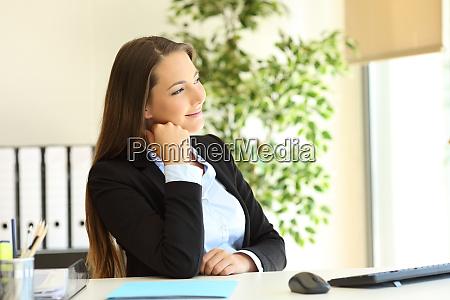 pensive executive looks through a window