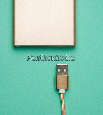 golden power bank and cord with