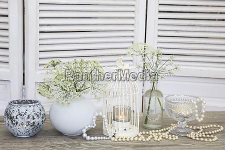 white nostalgic still life with birdcage