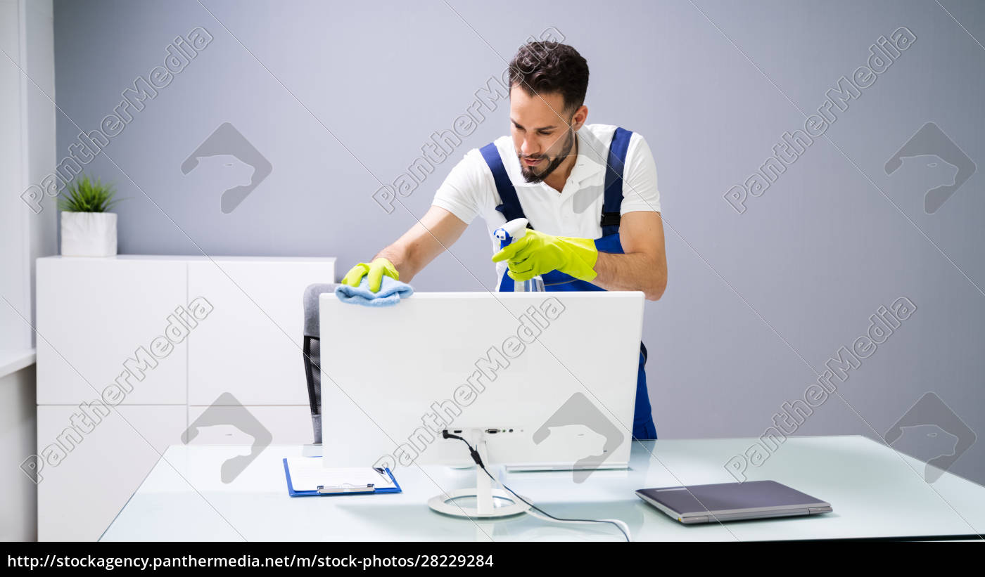 male, janitor, cleaning, computer, in, office - 28229284
