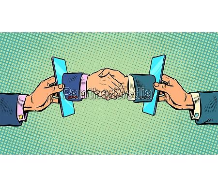handshake deal business online communication smartphone