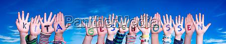 children hands building word kita geschlossen
