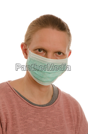 woman with mouth protection and mask