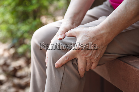 senior woman suffering from pain in