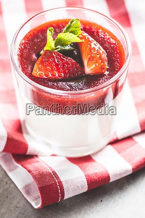 italian dessert panna cotta with strawberries