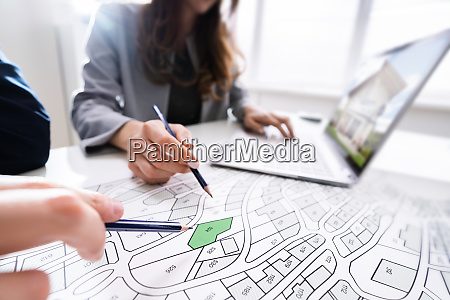 two people looking at cadastre map