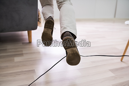 man legs stumbling with an electrical