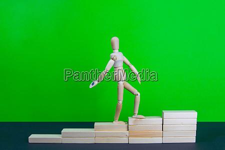 wooden man walk up the career