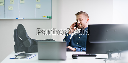 concentrated businessman working on computer