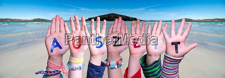 children hands building word auszeit means