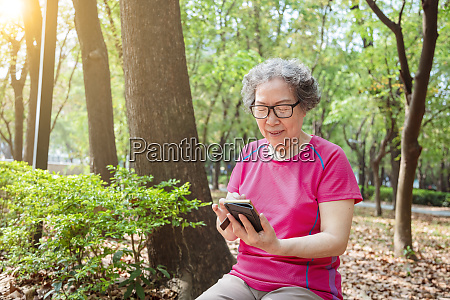 asian senior woman in glasses and