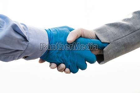 shaking hands in gloves