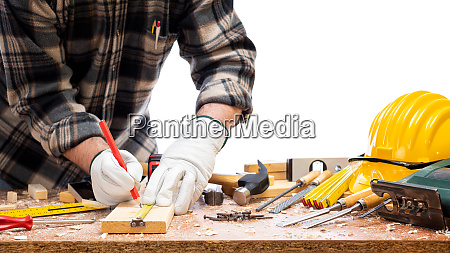 carpenter at work on wooden boards