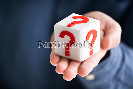 question mark block on persons hand