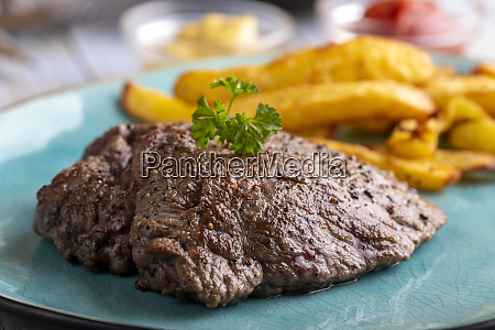 steak on a plate with french