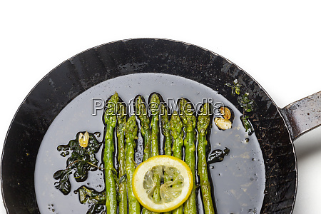 green asparagus in an iron pan