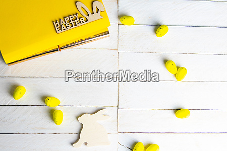 yellow notepad with wooden rabbit and