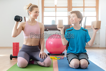 mother and son doing weight training