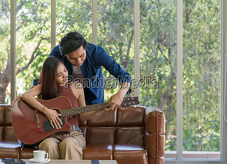 the young man teach his girlfriend