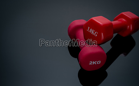 red and dark pink dumbbells isolated