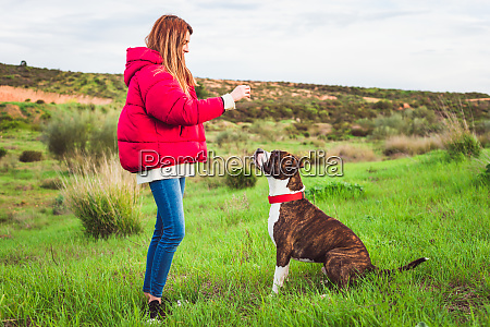 young woman with red coat and