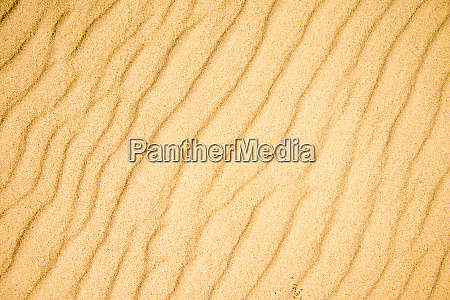 sand of a beach with wave