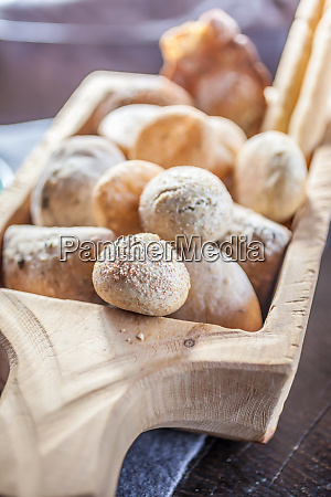 delicious basket with bread rolls on