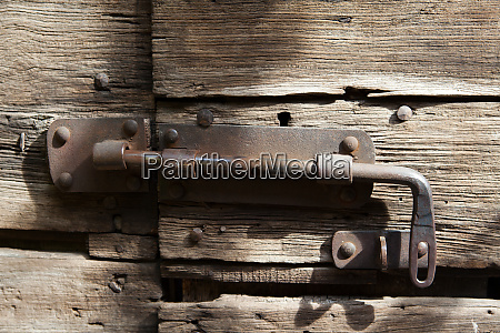 old door lock on a wood