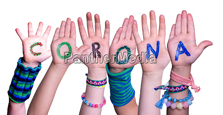 children hands building word corona isolated